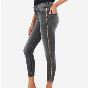 Express black skinny jeans with cheetah stripe
